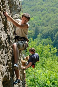 young sportsman climbing on the rock